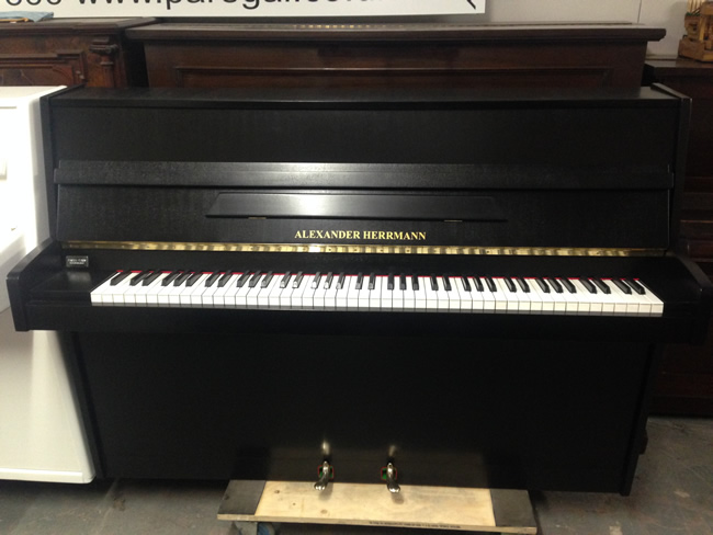 Alexander Herrmann upright piano for rental.