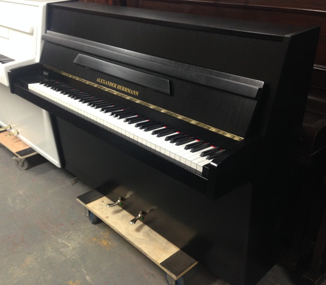 Alexander Hermann upright piano in a Black satin finish.