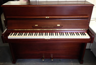 August Forster upright piano in a Mahogany satin finish.