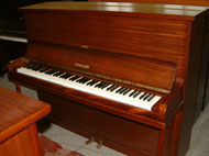 Challen upright piano in a Mahogany satin finish.