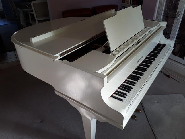 Chappell ivory baby grand piano.
