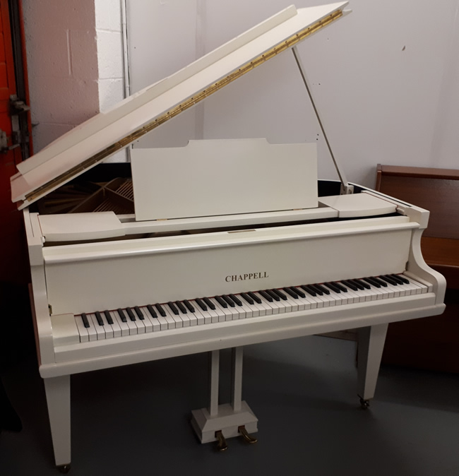 Chappell restored baby grand piano in a Ivory satin finish.