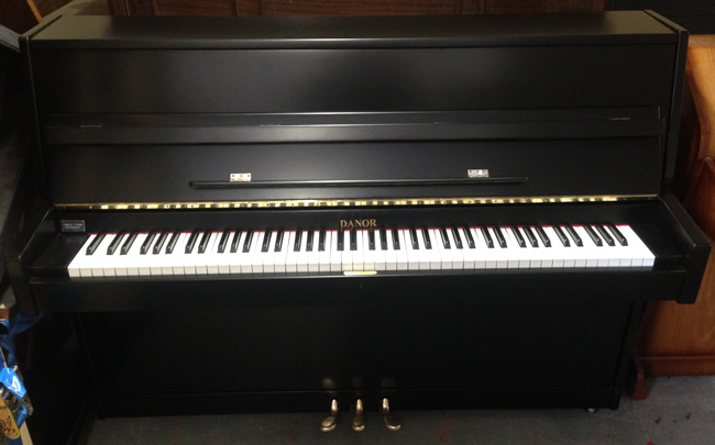 Danor black gloss upright pianos.