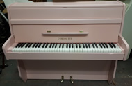 Coronette Baby Pink satin six octave small modern upright piano.