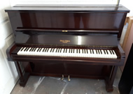 Dale Forty traditional upright piano.