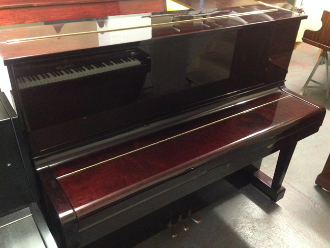 Dark Mahogany gloss piano.