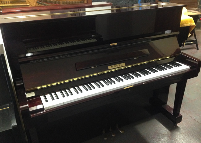Deste upright piano in a Mahogany high gloss finish.