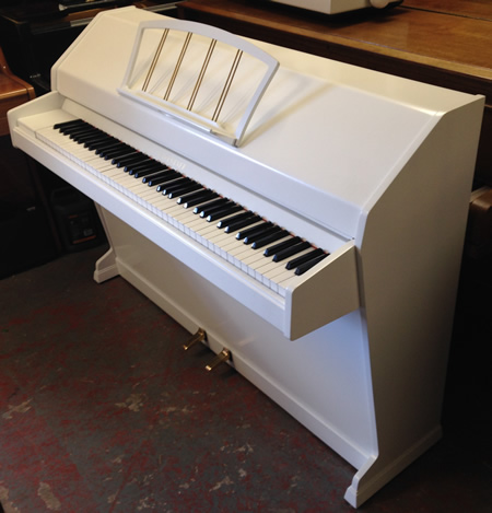 Sideview of eavestaff miniroyal piano.