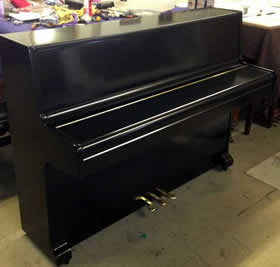 White or Black small modern hire pianos.