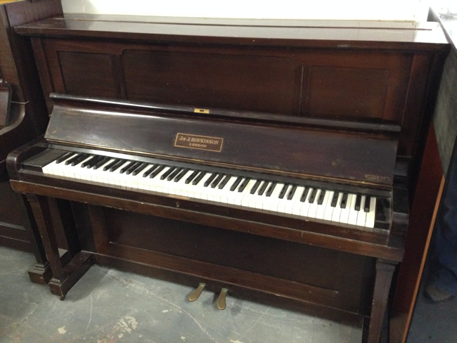 Hopkinson upright piano in a Mahogany satin cabinet.