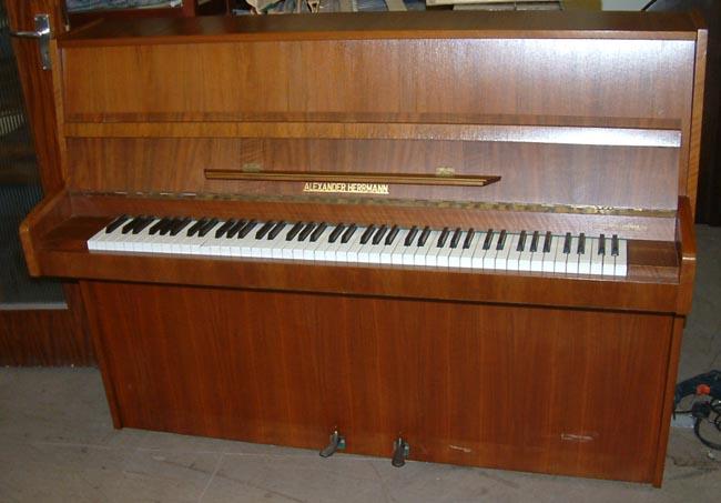 German Alexander Herrmann Modern Upright Piano In A Walnut
