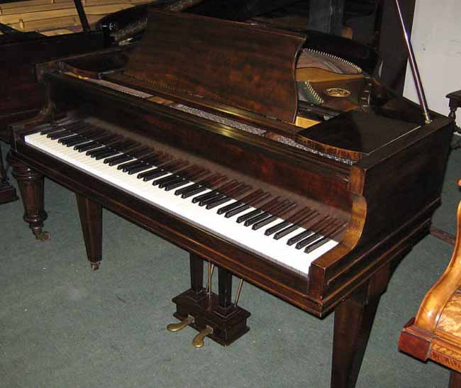 Roger baby grand before being restored