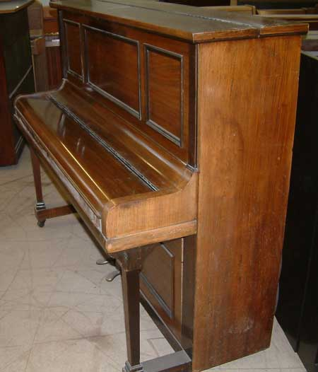Rogers upright piano in a Rosewood Cabinet