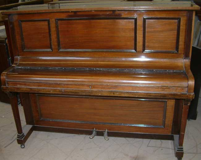 Rogers traditional upright  in a Fiddleback Mahogany cabinet