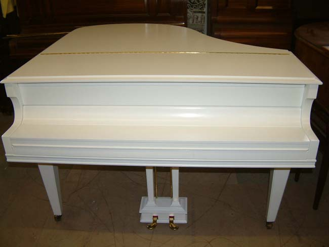 White satin grand piano