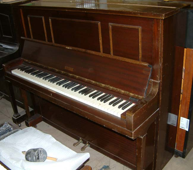 Steck upright piano for rent.