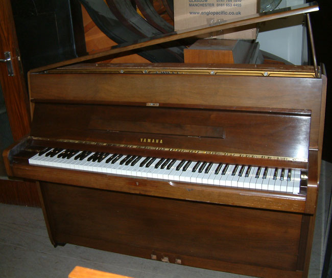 Yamaha piano m1 small modern upright piano in a walnut for Small upright piano dimensions