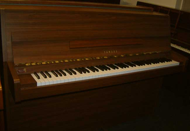 Yamaha mc108 small modern upright piano in a walnut cabinet for Small upright piano dimensions