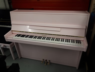 Kemble pink satin upright piano.