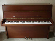 Knight K10 reconditioned upright in a Mahogany satin finish.