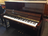 Richter mahogany gloss upright piano.