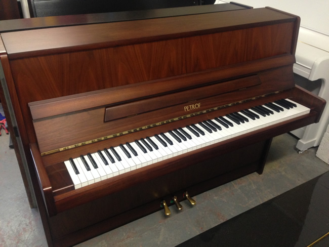 Petrof modern upright piano in a walnut satin finish.