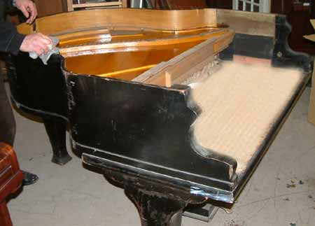 Piano before being re-polished White Satin.