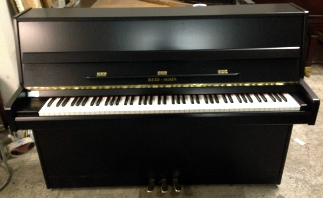 Reid Sohn Modern Upright Piano In A Black Satin Cabinet