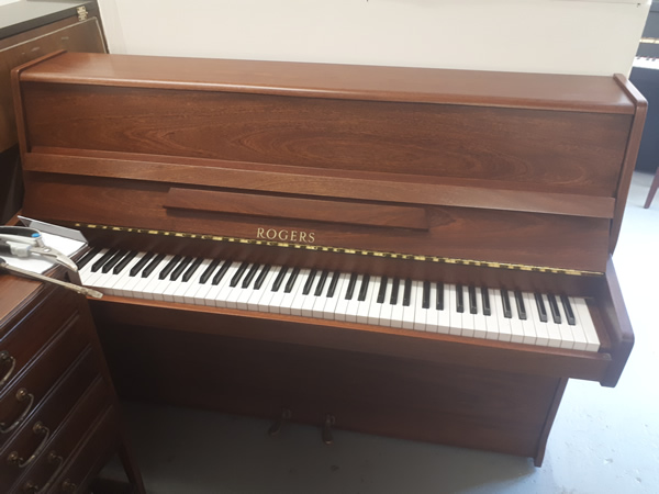 Rogers upright in a Light Mahogany cabinet