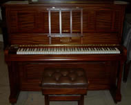 Rogers Traditional upright piano in a Mahogany satin cabinet.