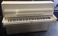 Waldstein modern upright in a white gloss cabinet.