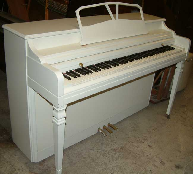 wonderful small upright piano dimensions #2: Wurlitzer modern piano in a White Satin cabinet.