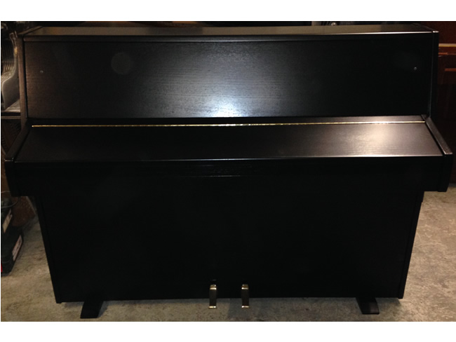 Zender piano in a Black satin finish.