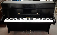 Zender Black gloss upright pianos.