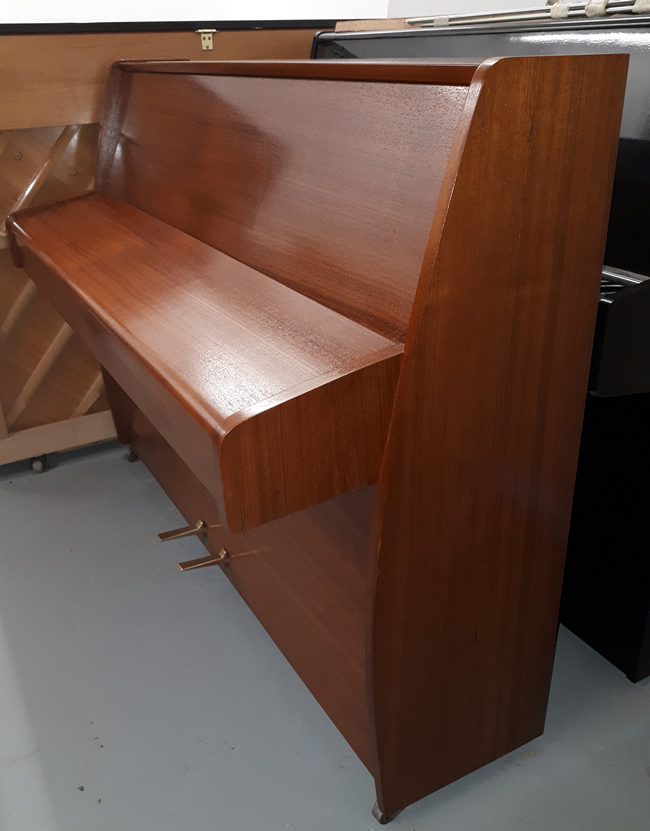 Zender Teak satin upright piano sideview.
