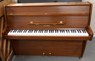 Zender upright piano in a Teak satin finish.